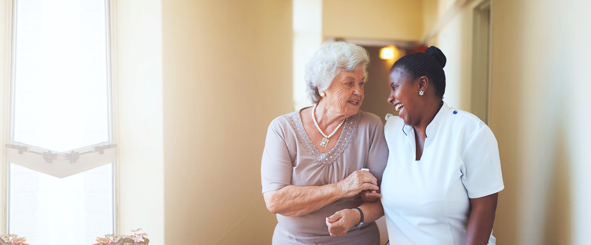 elder woman and her caregiver talking